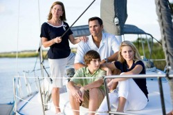 Family on a sail boat wearing resort wear